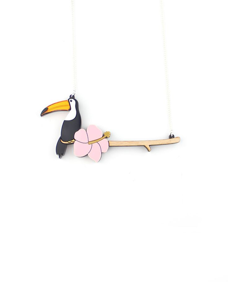 Toucan and flower necklace, On top of an infinite branch lays a toucan. It has a beautiful black and white plumage although its orange beak catched all of the explorers' attention. We can see a beautiful, colorful pink flower next to it.  Laser-cut beechwood branch and toucan with flower in mirror and opaque acrylic. Made and assembled by hand.  LIMITED EDITION to 15 pieces.