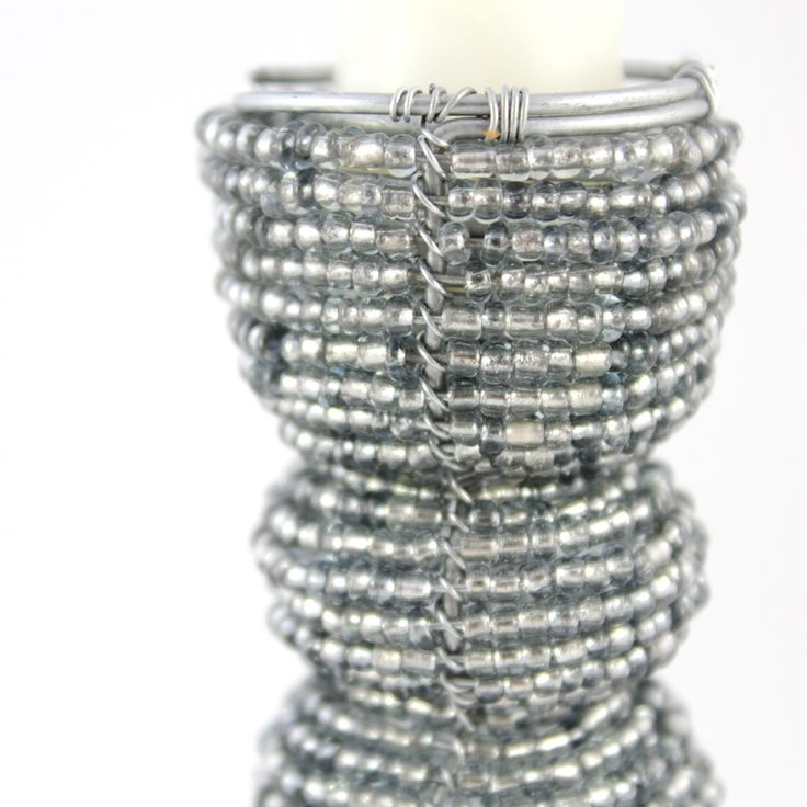 Close up view of beaded candle stick holder.