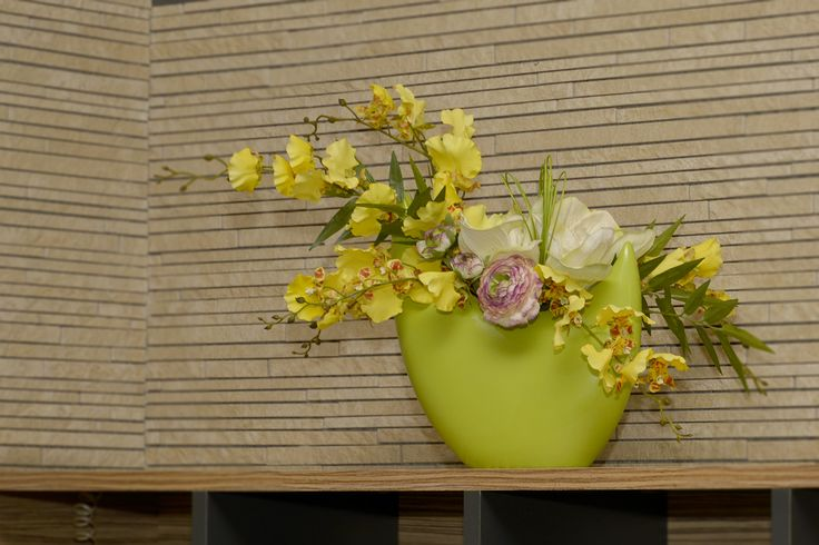 Yellow Orchids in Green vase, real touch flowers.