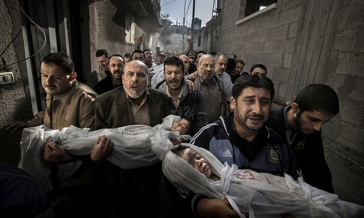 The defining images of 2012: Stunning pictures from the World Press Photo Awards capture every extreme of human life, from Olympic glory to Indian poverty to despair in war-torn Gaza
