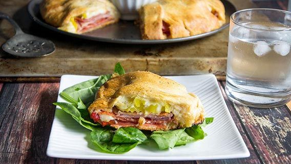 Bring all the flavors of your favorite sandwich to the party with this crescent bake. Layers upon layers of savory meats and cheese keep you coming back for more.