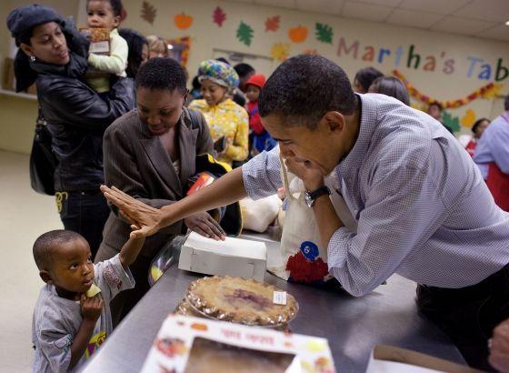 President Barack Obama gets a high five at Martha's Table