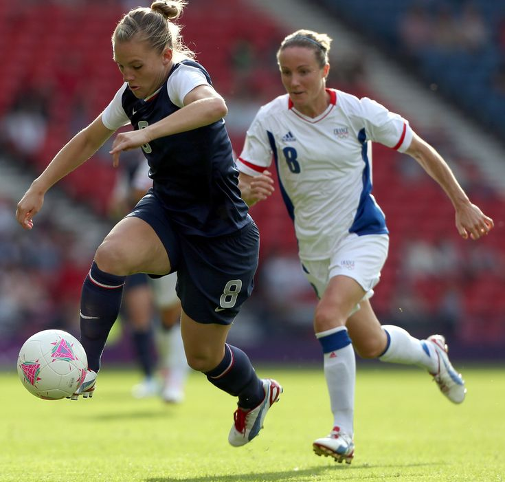 Amy Rodriguez of USA is chased by Sonia Bompastor of France during the Women's Football first round Group G Match of the London 2012 Olympic Games between United States and France, at Hampden Park on July 25, 2012 in Glasgow, Scotland.