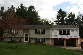 Bedroom and garage addition raised ranch house in Westfield MA - other end of the house, though