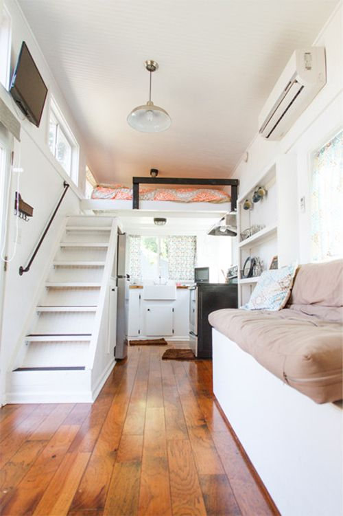 The 24' tiny house features 10 large windows, French doors, premium walnut hardwood floors, and a full kitchen.