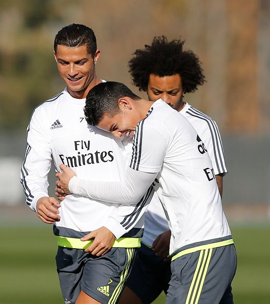 Cristiano Ronaldo James Rodriguez and Marcelo Vieira of Real Madrid warms up during a training session at Valdebebas training ground on November 20...