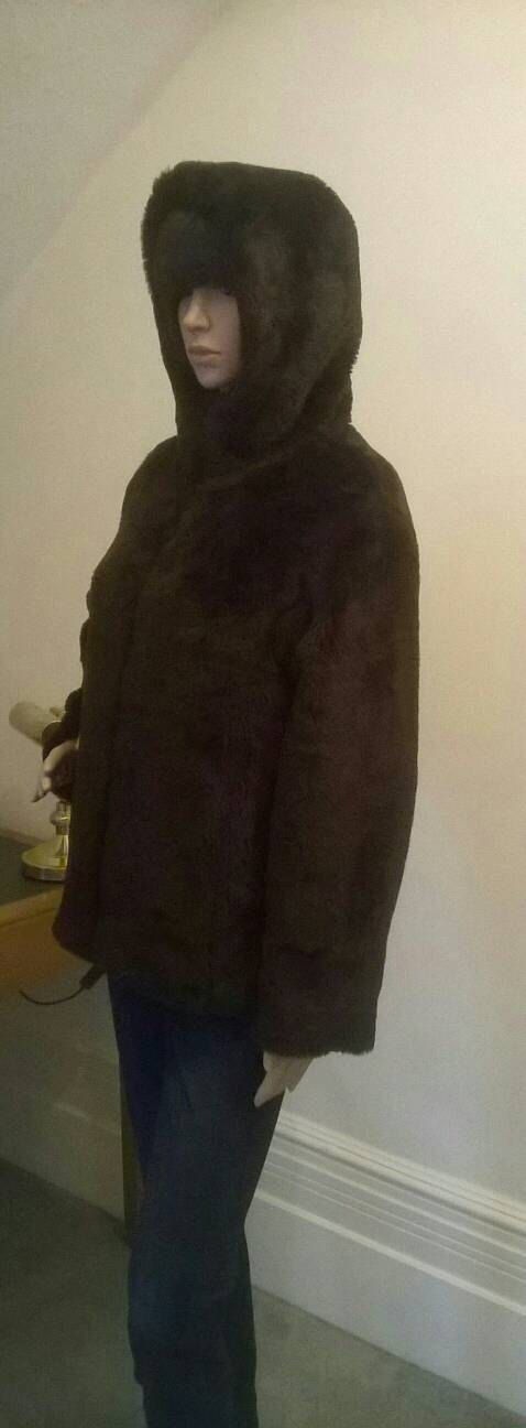 Such a cute little jacket. Nice and warm and great with jeans. Lovely to have the option of a hood in this weather. Brown faux fur. Zip up front. 2 side pockets. The mannequin is a size small. The jacket is size 38, I would say this is a medium size. In good condition. Lined in brown satin.