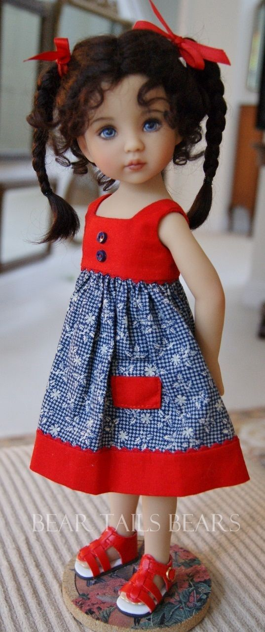 Love the hair style. Must use on the next doll I'm making with the purple and green dress