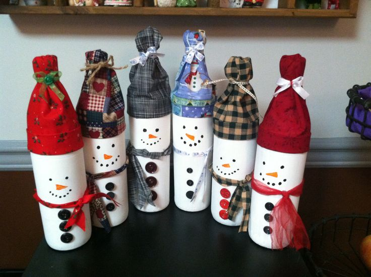 Snowmen made from wine bottles.