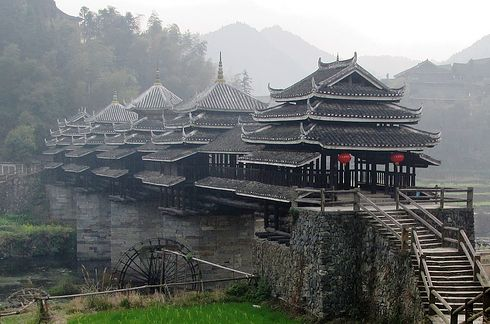 The bridge of the wind and rain of Chengyang, Liouzhou, Guangxi, China.  According to legend, there was once a couple who were walking through it when the wife was kidnapped by an angry spirit. Crying Husband woke flower dragon who lived in the river and the Dragon captured the spirit and the couple met. Therefore, this bridge has been a meeting point for lovers.