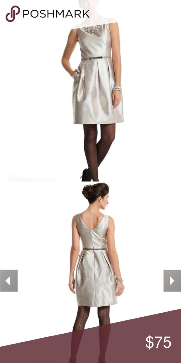 [BHWM] NWOT Gold Tulip-Skirt Dress - sz 4 NWOT || celebrate in the shimmer of soft champagne gold. This glamorous cocktail dress channels Holly Golightly sophistication with pockets and a bateau neckline that changes to a drop-V in back. Comes with a bronzed gold belt with a hematite-finish buckle. Also shown with the Gold Glitter Bow Skinny Belt. Shell: 87% Polyester, 13% Metallic. Lining: 96% Polyester, 4% Spandex. Dry clean. Imported. White House Black Market Dresses