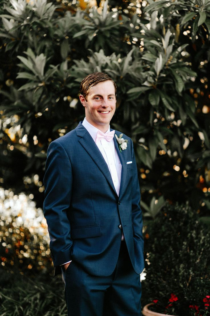 Groom style inspiration: Navy suit and light pink bow tie (Gloria Goode Photography)