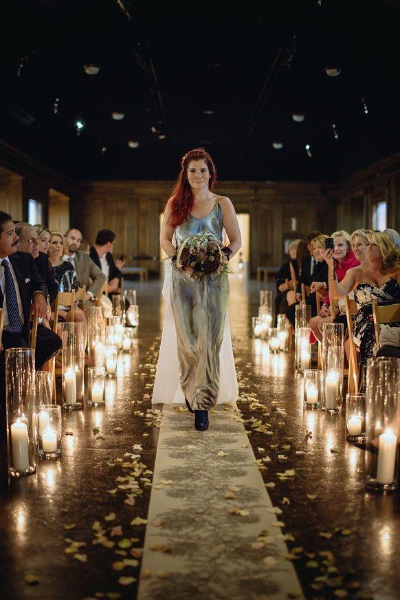 Lush candlelit wedding aisle.