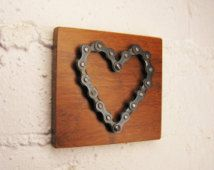 Bicycle chain heart on bamboo