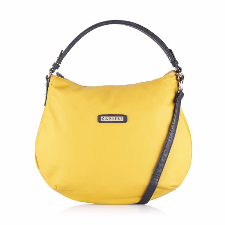 Caprese Lini Hobo yellow. Gain the admiration of your friends as you step out in style carrying this yellow hobo bag that boasts of a vibrant hue and a casual design. This pretty looking bag will complement all your daily wear.  Check out in store:https://acebazaar.in/product/caprese-lini-hobo-medium-yellow/