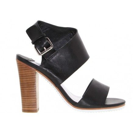 A black leather woodstack heel with a wrapped covering complete with a buckle for entry and a white cleated sole.   Leather upper and synthetic lining.  Heel height is 10.5cm.