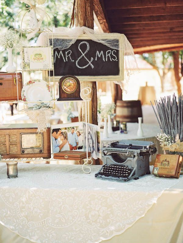detailed vintage decor at wedding reception #vintage #weddingreception #tabledecor http://www.weddingchicks.com/2014/01/21/vintage-southern-wedding/