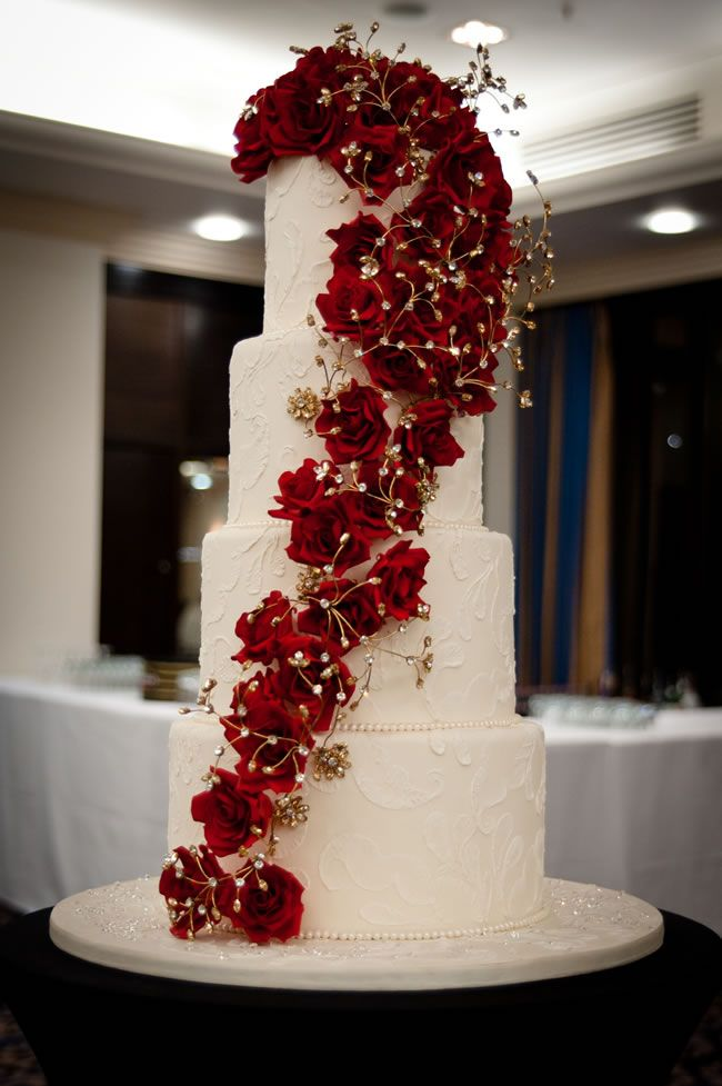 british christmas wedding cake | Cascading flowers are a hot trend for 2013 © Claire Graham