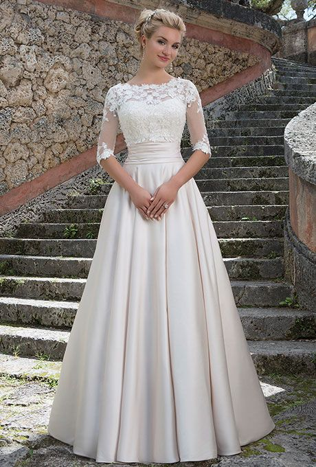 Brides: Sincerity Bridal. Grace Kelly inspired ball gown features a beaded Sabrina lace bodice, satin cummerbund, and a full skirt with pockets. The stretch beaded lace jacket completes this refined look.