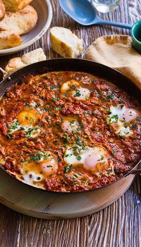 Baked eggs in spicy tomato sauce: Heat up brunch with eggs to rival those fancy cafes.