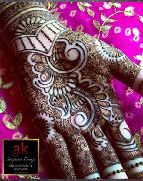 EXECUTIVE ARTIST & EDUCATOR BRIDALHENNA PLATINUM: $700 Traditional heavy bridal henna full arms (to elbow) and henna design on feet past ankle. Bonus: