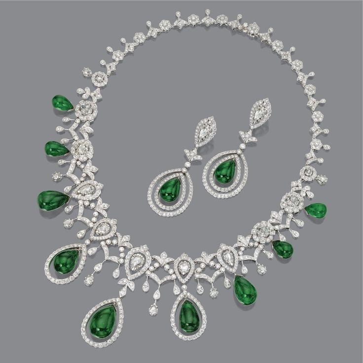 DIAMOND AND EMERALD NECKLACE AND EARRINGS Estimate  50,000 — 60,000  USD  LOT SOLD. 79,000 USD