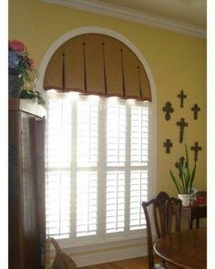 Image result for taylored drapery for arched windows