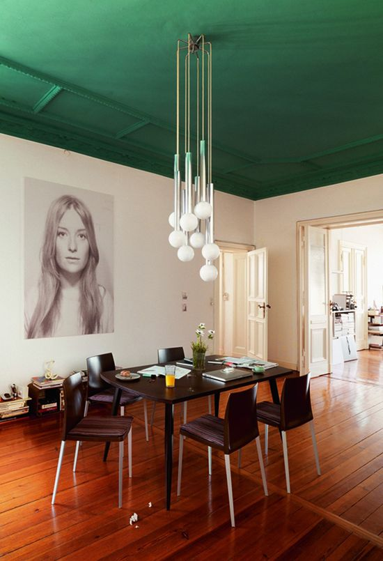 Green painted ceiling, cool light, and statement art