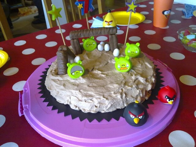 Easy Angry Birds cake with chocolate whip cream, Twix bars and plastic figures from the board game,