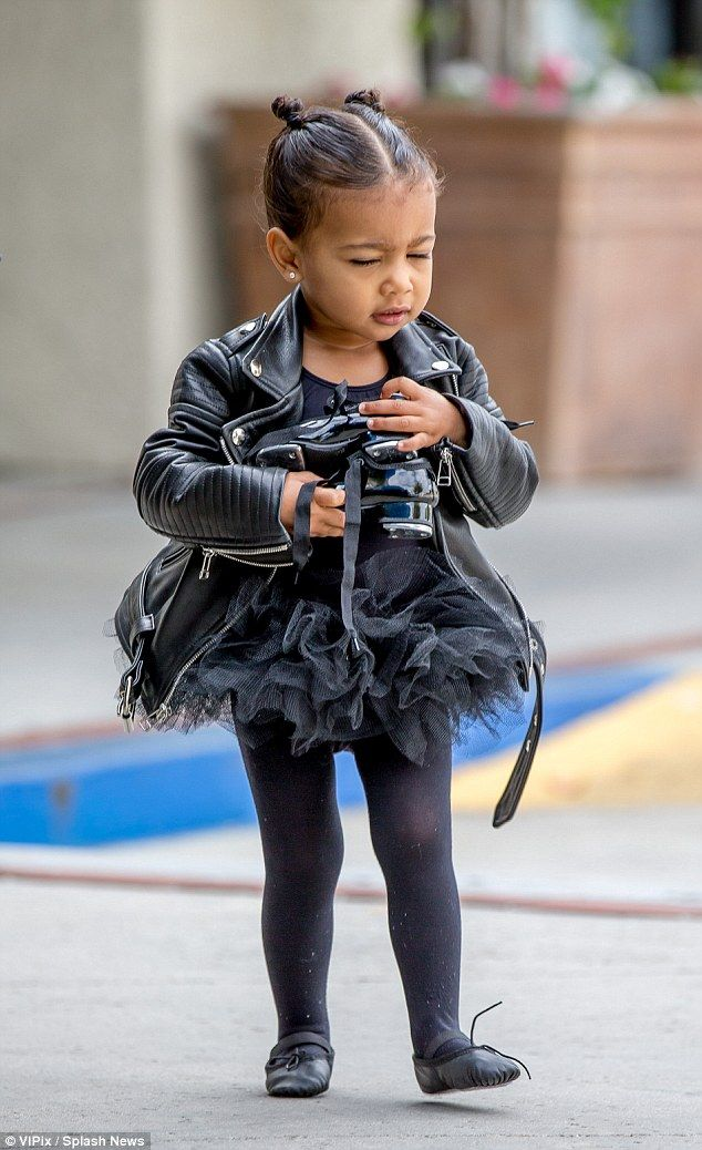 Tapped out: the tot seemed to be struggling with the weigh of her tap shoes buy was determ...
