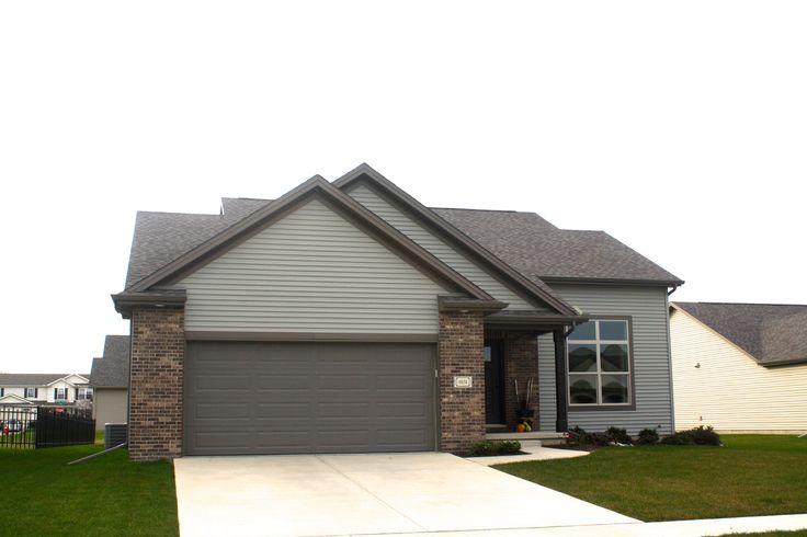 Sometimes a lighter green siding can appear darker if for Dark brown exterior trim