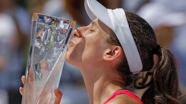 Johanna Konta claims the biggest title of her career with victory over Caroline Wozniacki in the Miami Open final.