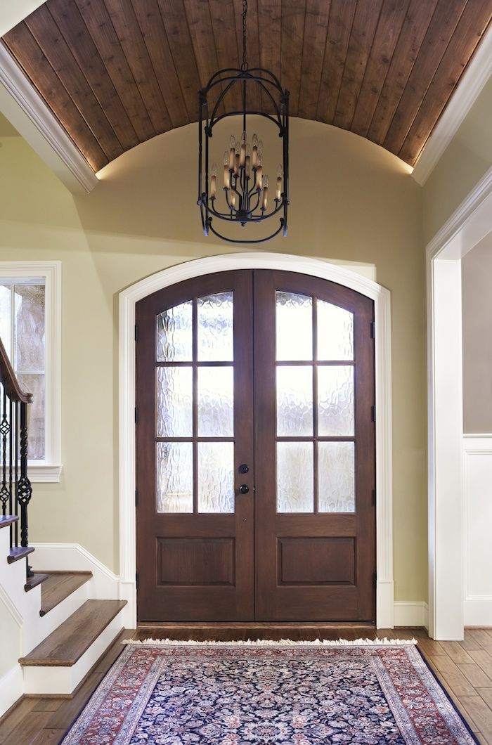Foyer with beautiful wooden barrel vault ceiling. -Milestone Custom Homes-