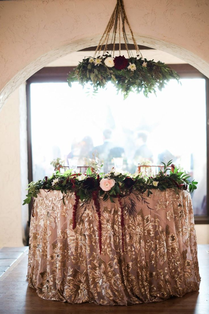 Wedding sweetheart table, centerpiece garland and floral chandler, lush greens, blush, gold, white, burgundy Marsala wedding flowers
