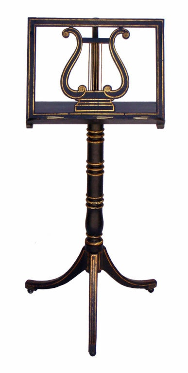 Regency Painted & Gilt Decorated Music Stand, C1810  England  C1810  Regency Painted & Gilt Decorated Music Stand, C1810. Classic design with lyre center, telescoping adjustable top, turned & banded column ending in a tri-pod base and small ball feet.