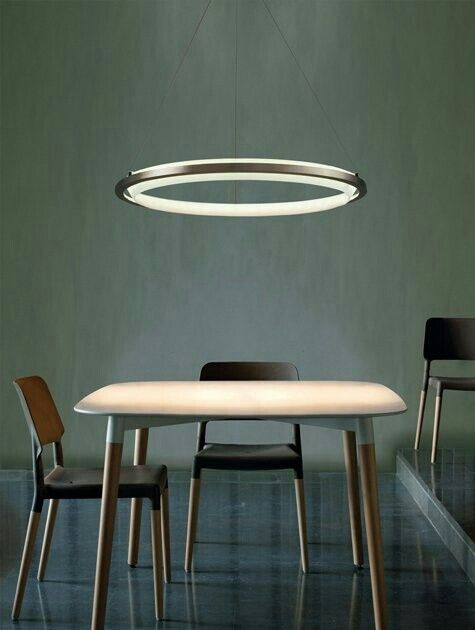Minimalist Décor here really highlights the style of the lighting and the table.