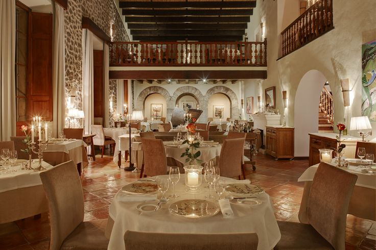 Flickering candlelight creates a romantic, elegant ambience to complement the Mediterranean cuisine of Executive Chef Guillermo Méndez at El Olivo