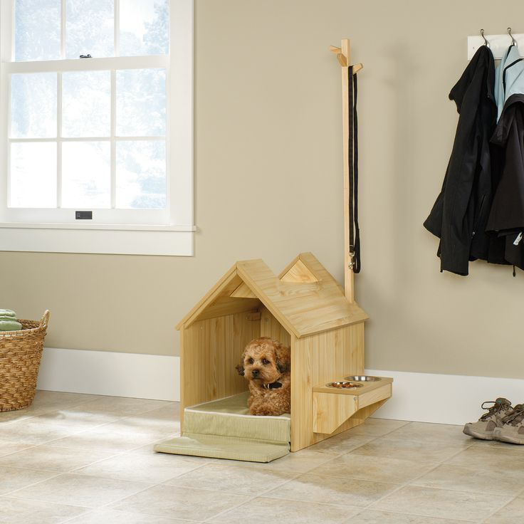 Give your dog their own home within your home with this awesome pinewood dog house and pet station