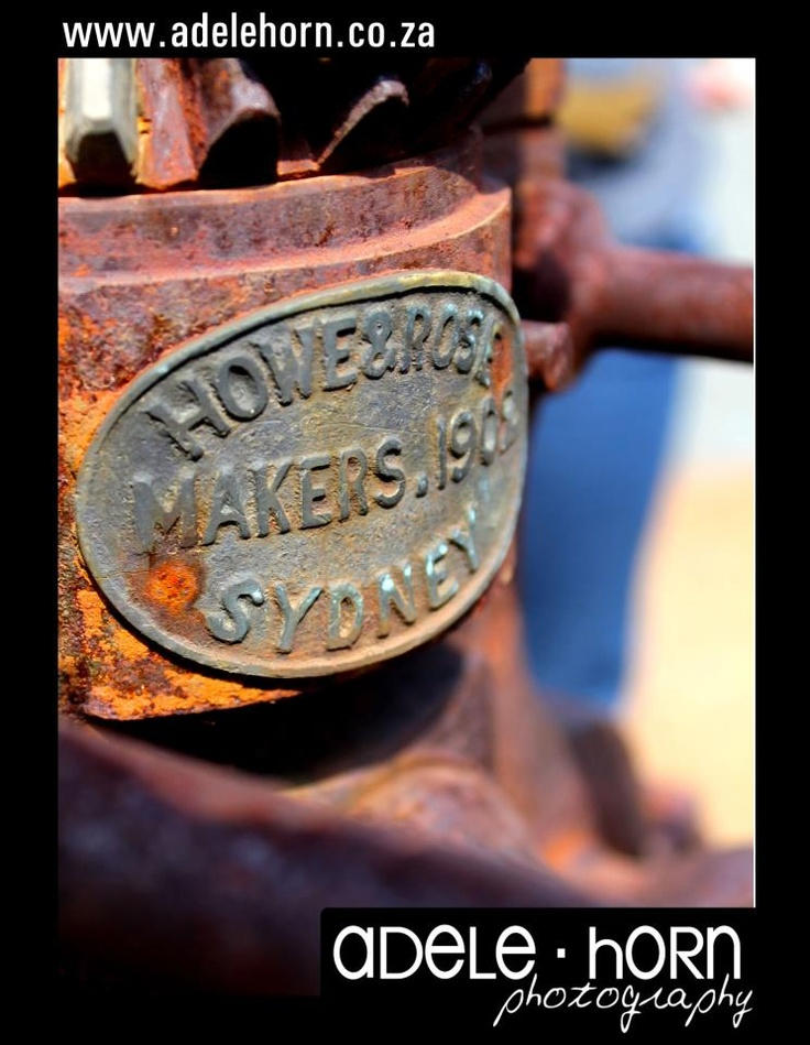 rusted nameplate on a antique tin press