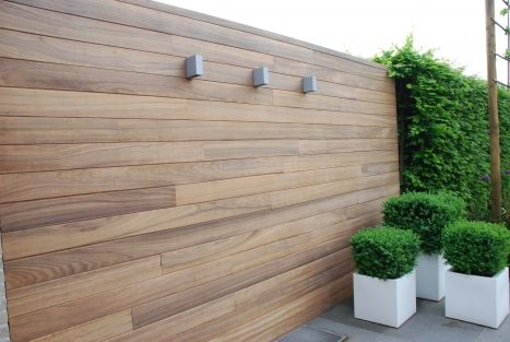 Fencing with lighting and plant pots