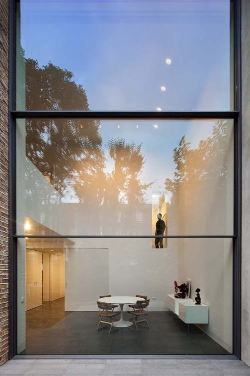 House on Bassett Road, by Paul+O Architects.