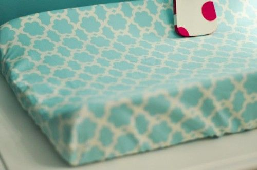Don't spend money on a changing pad sheet when you can do it yourself!  Much cuter than store bought and cheaper!