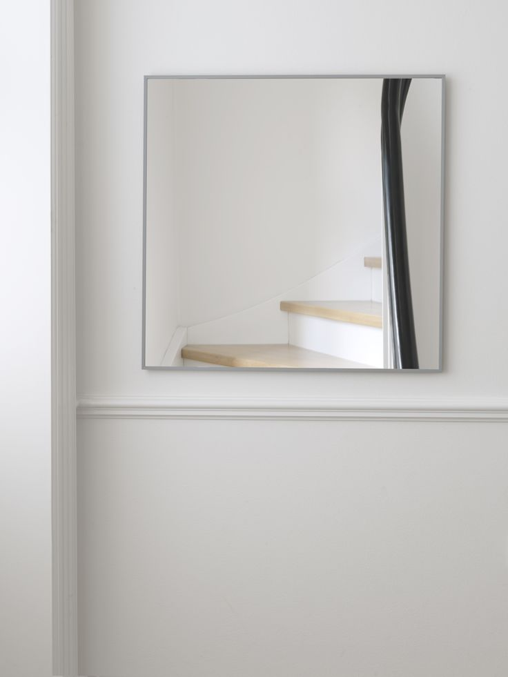 View Mirror from by Lassen. Mirror, mirror on the wall, who's the fairest of them all? Characteristic, simple and timeless design is the hallmark of the View mirror, which seems to float out from its place on the wall. Hang the mirror in your foyer, your bedroom or along with your artworks in your living room.