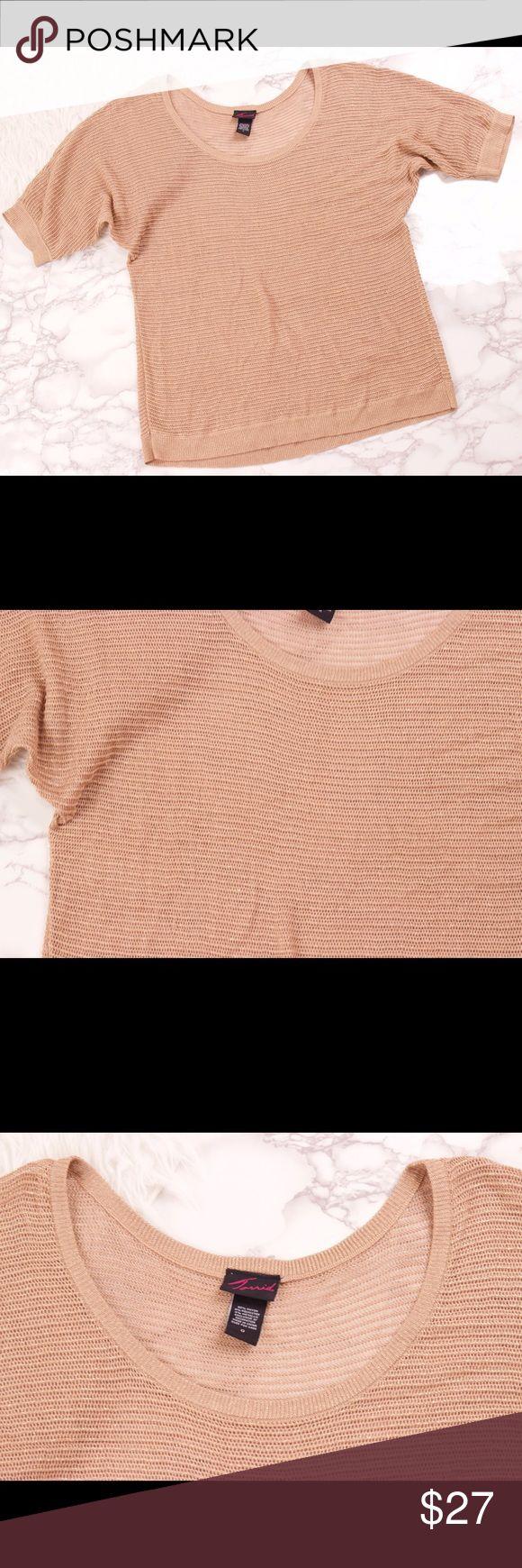 Torrid gold loose knit blouse top plus size Torrid gold metallic loose knit blouse top. Draped batwing sleeves. Scoop neck. Size 0 brand sizing   Shoulder-22 Sleeve-7 Bust-42 Length-28 torrid Tops Blouses