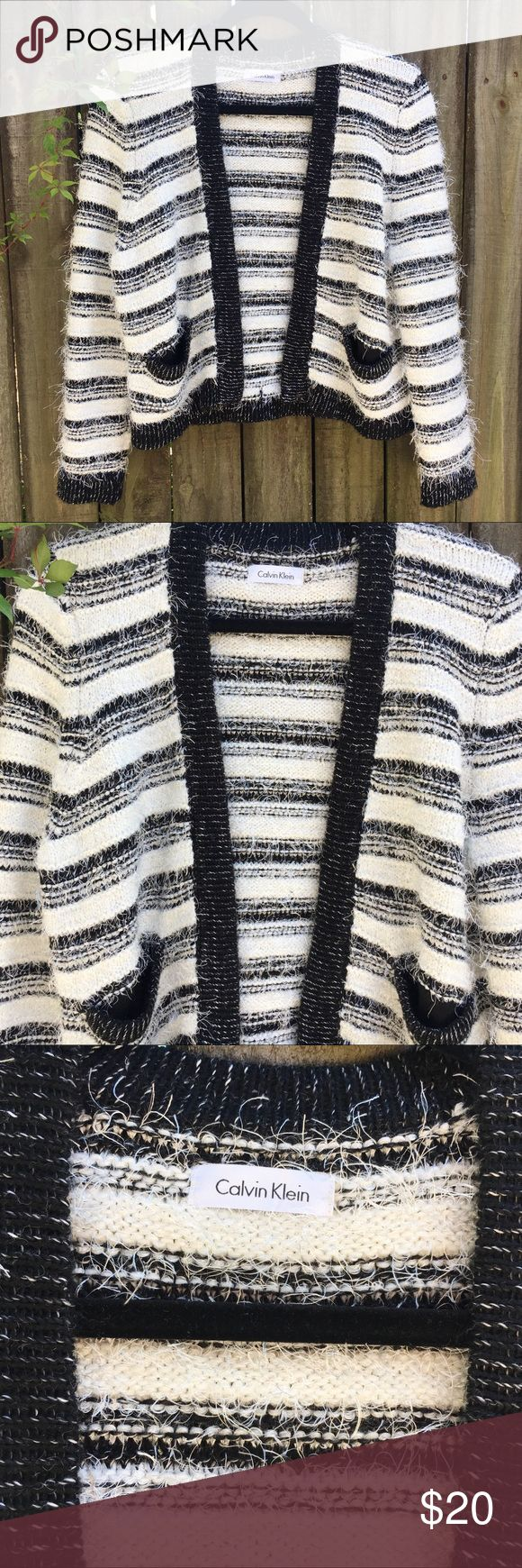 Calvin Klein black and white cardigan Beautiful Calvin Klein open cardigan sweater woman's. Small. Black and white Tricot. Shell: 45% polyester, 38% acrylic, 17% ramie Calvin Klein Sweaters Cardigans