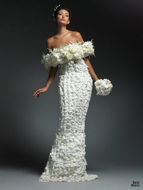 Looks like the dress is made from white rose petals.
