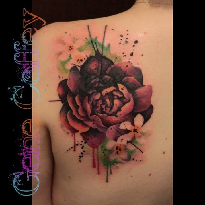Flower Cover-up Tattoo...Tattoo Idea by Tatu Lique! Like think ink splatter