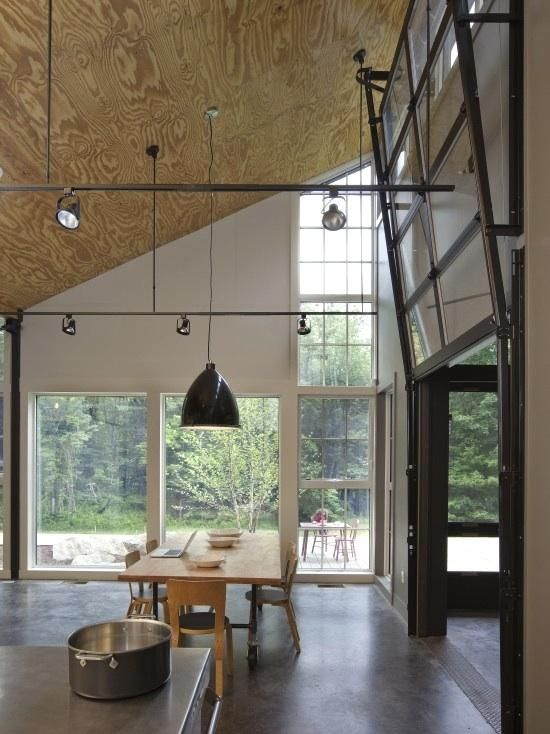 Plywood is used for the ceilings in a modern kitchen in Massachusetts [Cealing and garage door. What more could one ask for?]