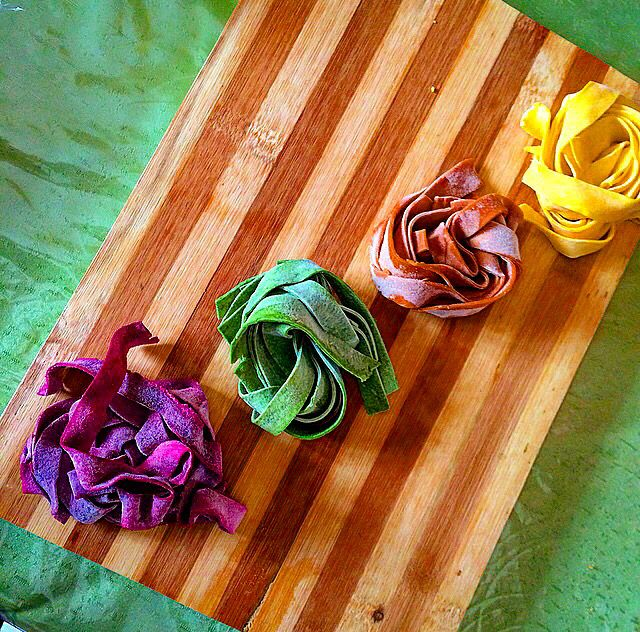 Handmade fresh pasta tagliatelle beetroot-spinach-chocolate-safran..