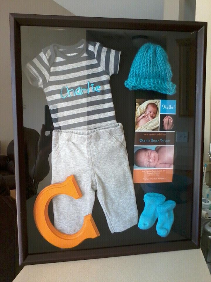 Clothes he wore home from the hospital and his birth announcement in a shadow box